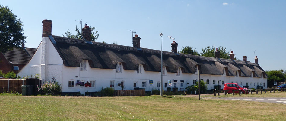 A terrace of thatched cottages